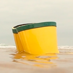 children wellingtons in the sea, half submerged