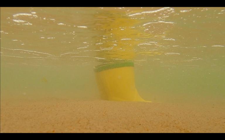 yellow wellingtons under water