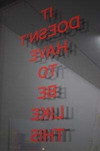 red vinyl text on a window - it doesn't have to be like this